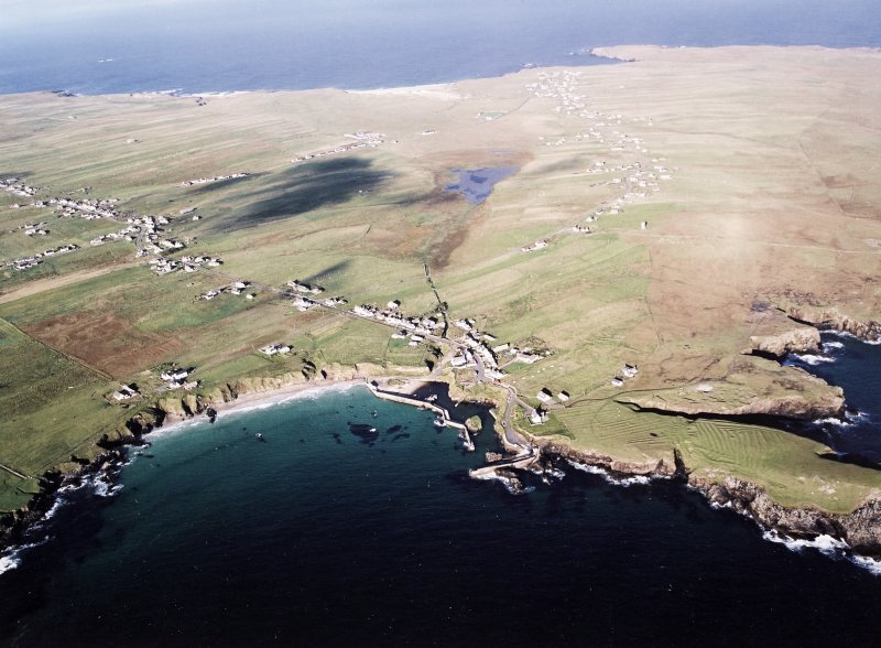 General oblique aerial view looking across the harbour, crofting township and lazy beds towards the townships, taken from the ESE.