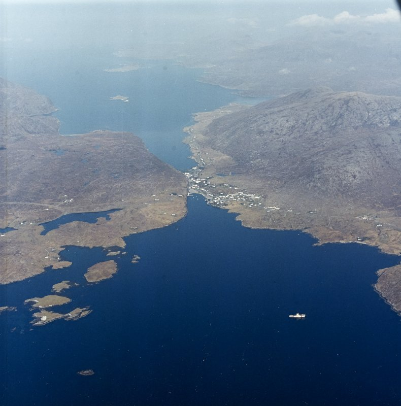 General oblique aerial view looking towards the village of Tarbet and Loch a Siar beyond, taken from the SE.