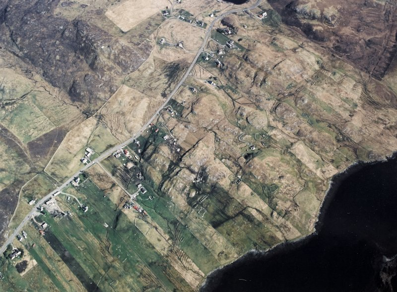 Oblique aerial view centred over the township and the remains of the buildings, taken from the SW.