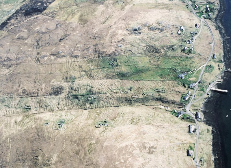Oblique aerial view centred on the township and the remains of the buildings, taken from the W.