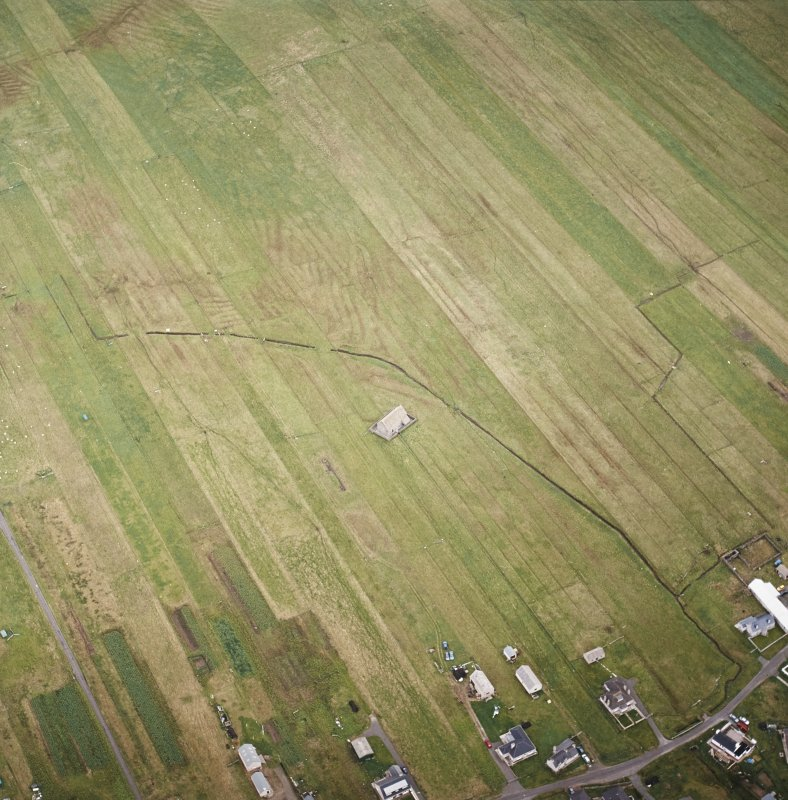 Oblique aerial view centred on the chapel, taken from the SW.