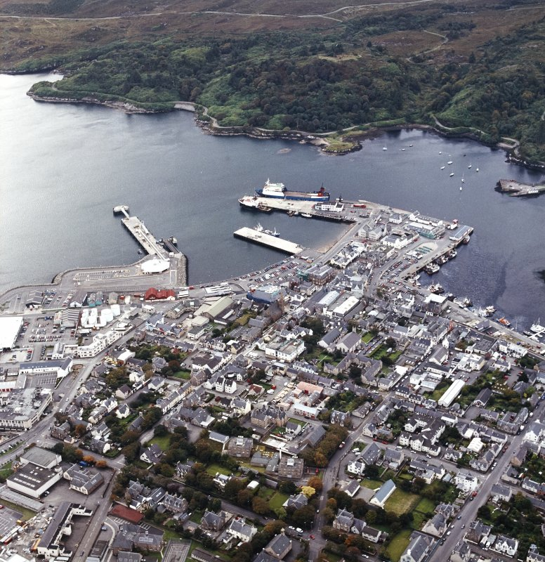 Oblique aerial view of Stornoway centred on the harbour, taken from the NE.