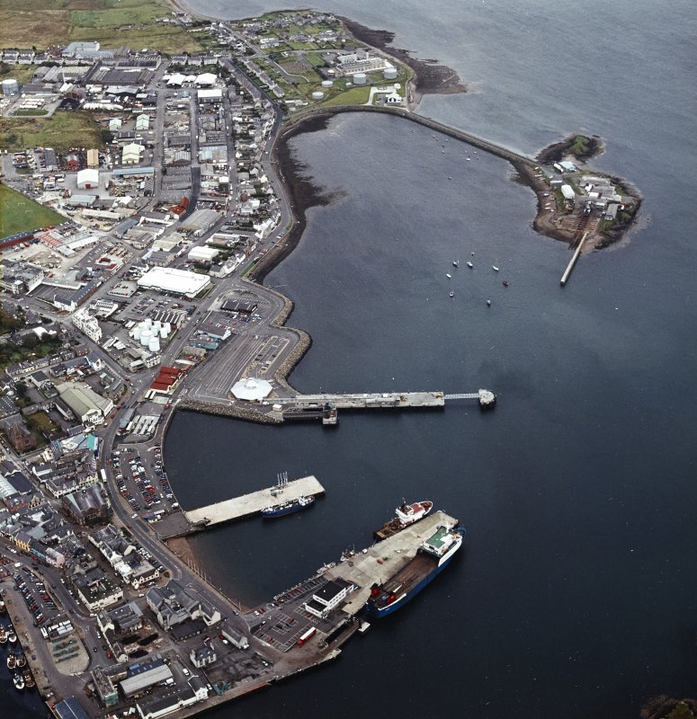 Oblique aerial view of Stornoway centred on the harbour, taken from the WNW.