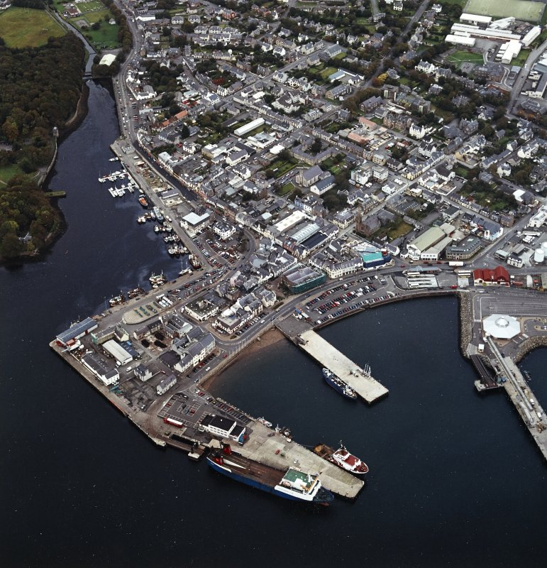 Oblique aerial view of Stornoway centred on the harbour, taken from the SW.