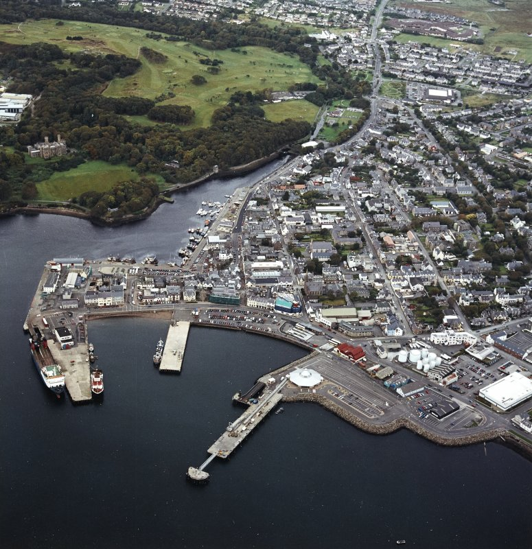Oblique aerial view of Stornoway centred on the harbour, taken from the SSE.
