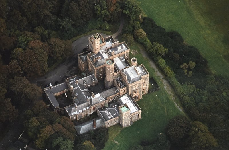 Oblique aerial view centred on the country house and college, taken from the W.