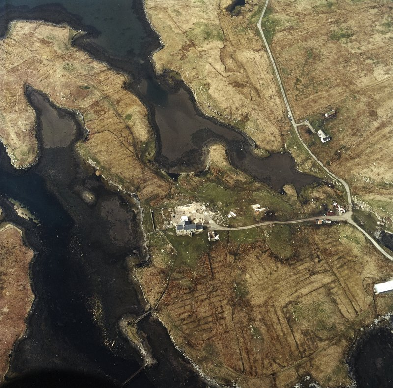 Oblique aerial view centred on the house and the site of the works, taken from the SE.