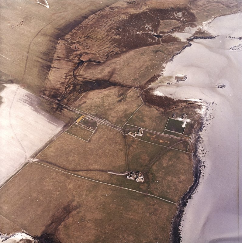 Oblique aerial view centred on the country house and the remains of the house, farmstead and walled garden, taken from the SW.