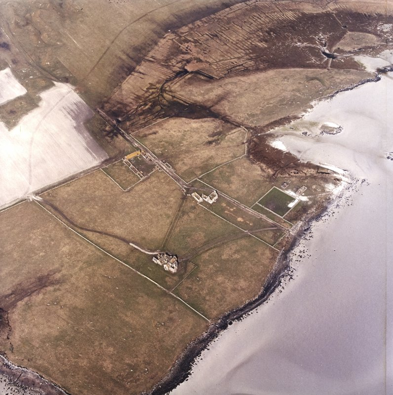Oblique aerial view centred on the country house and the remains of the house, farmstead and walled garden, taken from the SSW.