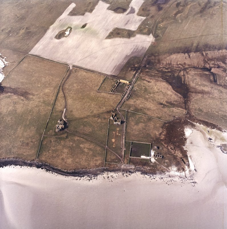 Oblique aerial view centred on the country house and the remains of the house, farmstead and walled garden, taken from the SE.