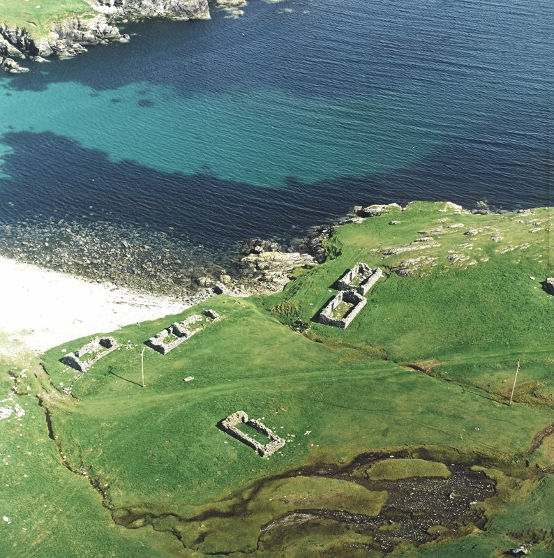Oblique aerial view centred on the remains of the fishing station, taken from the W.