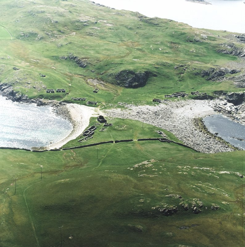 Oblique aerial view centred on the remains of the fishing station and prehistoric house, taken from the NE.