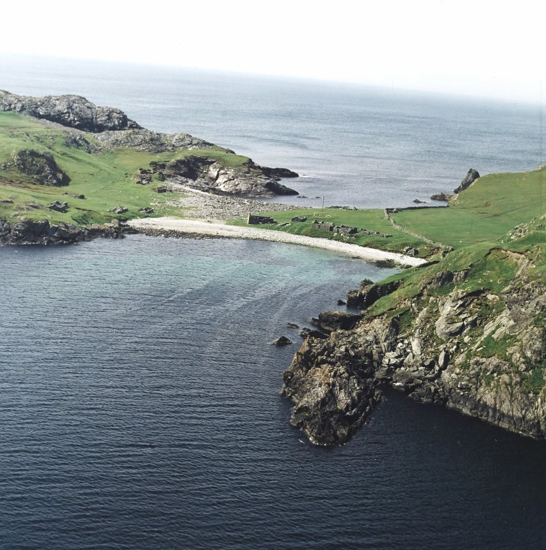 General oblique aerial view centred on the remains of the fishing station and prehistoric house, taken from the E.