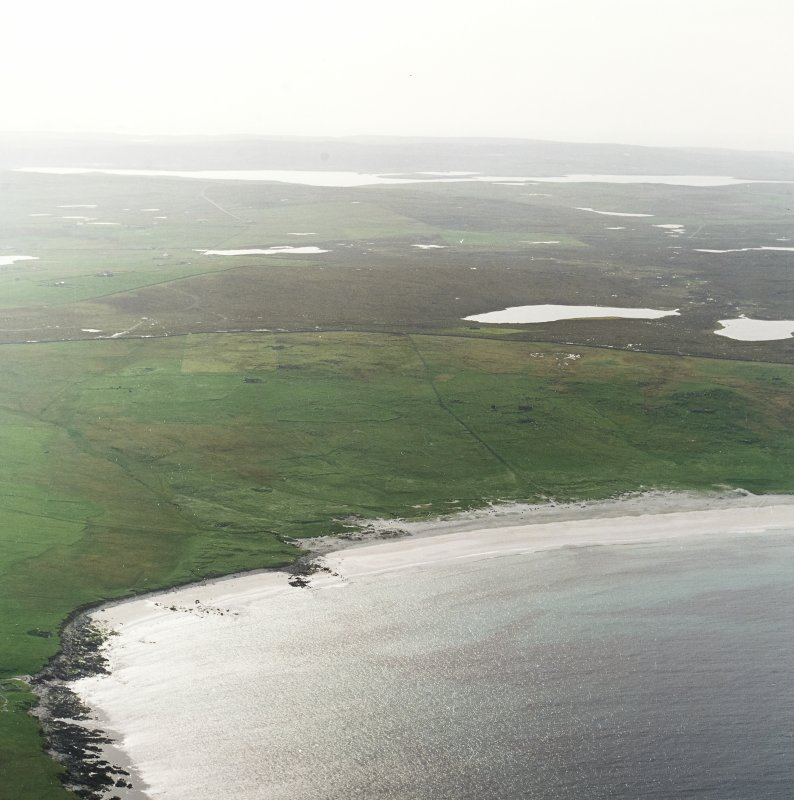 General oblique aerial view centred on the remains of the township, head-dyke and Viking settlement, taken from the ENE.