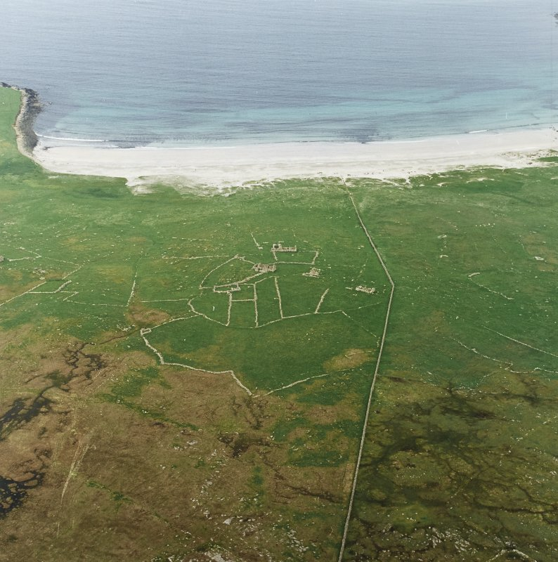 Oblique aerial view centred on the remains of the township and head-dyke, with the remains of the Viking settlement adjacent, taken from the WSW.