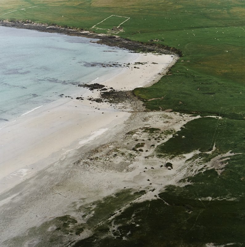 Oblique aerial view centred on the remains of the Viking Settlement, taken from the NW.