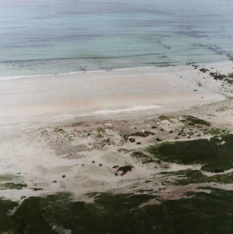 Oblique aerial view centred on the remains of the Viking Settlement, taken from the W.
