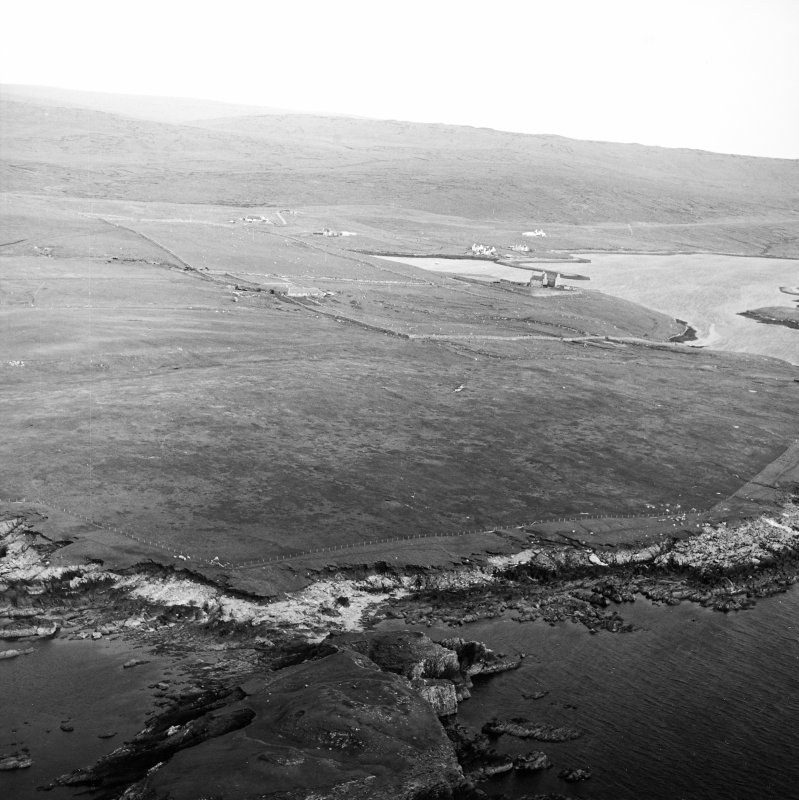 General oblique aerial view looking from the remains of the broch towards the Lairds House, taken from the NNW.