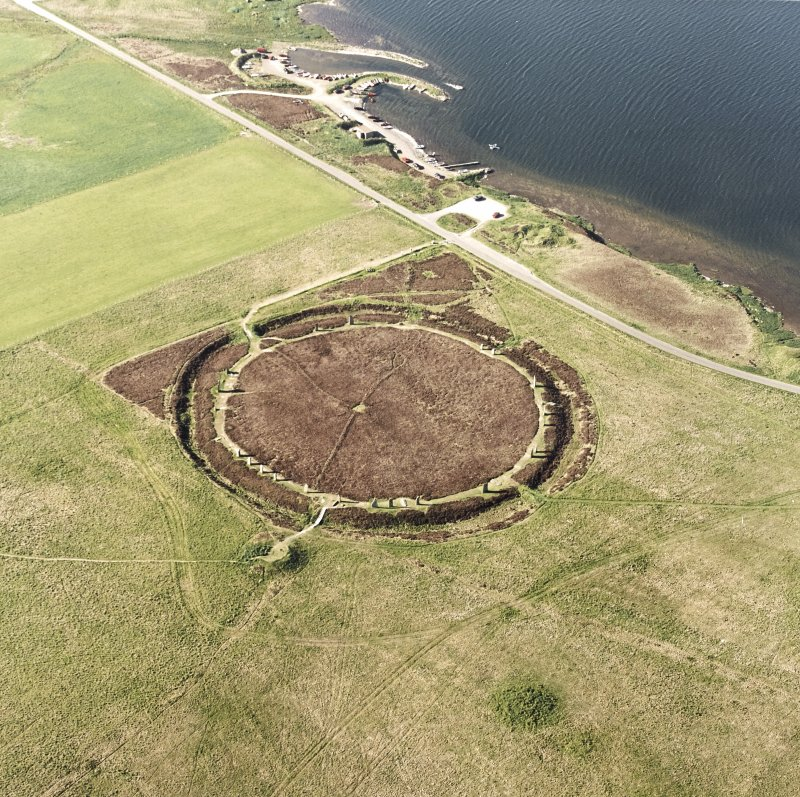 Aerial view of the Ring of Brodgar, henge and stone circle, taken from the SW.  Also visible are some of the surrounding cairns.