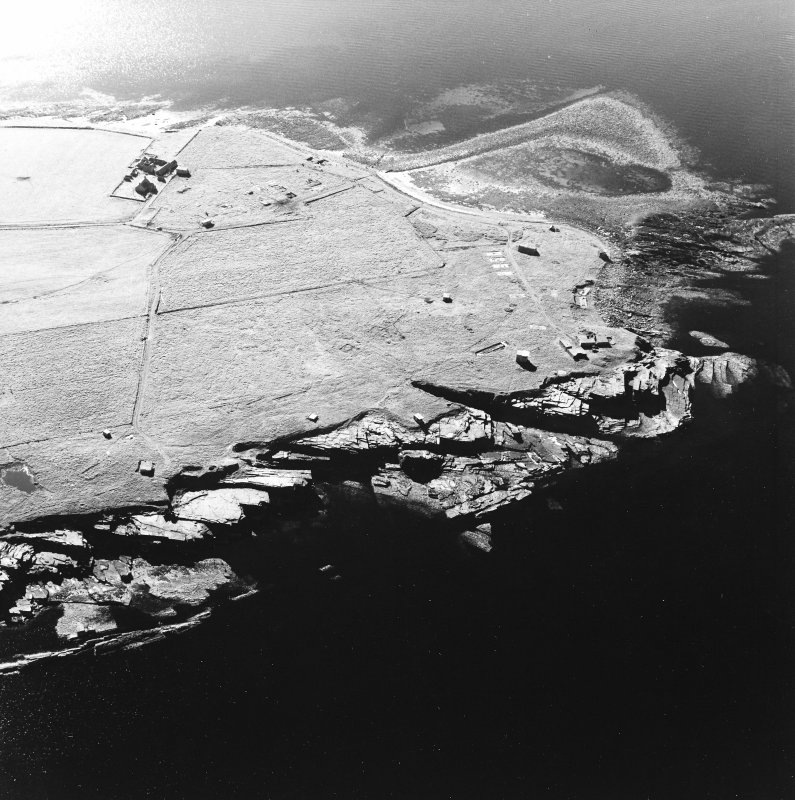 Oblique aerial view of Orkney, Rerwick Head, Rerwick Battery, taken from the E.  Visible are the gun-emplacements, battery observation tower, searchlight platforms and concrete hut bases for the accommodation camp.