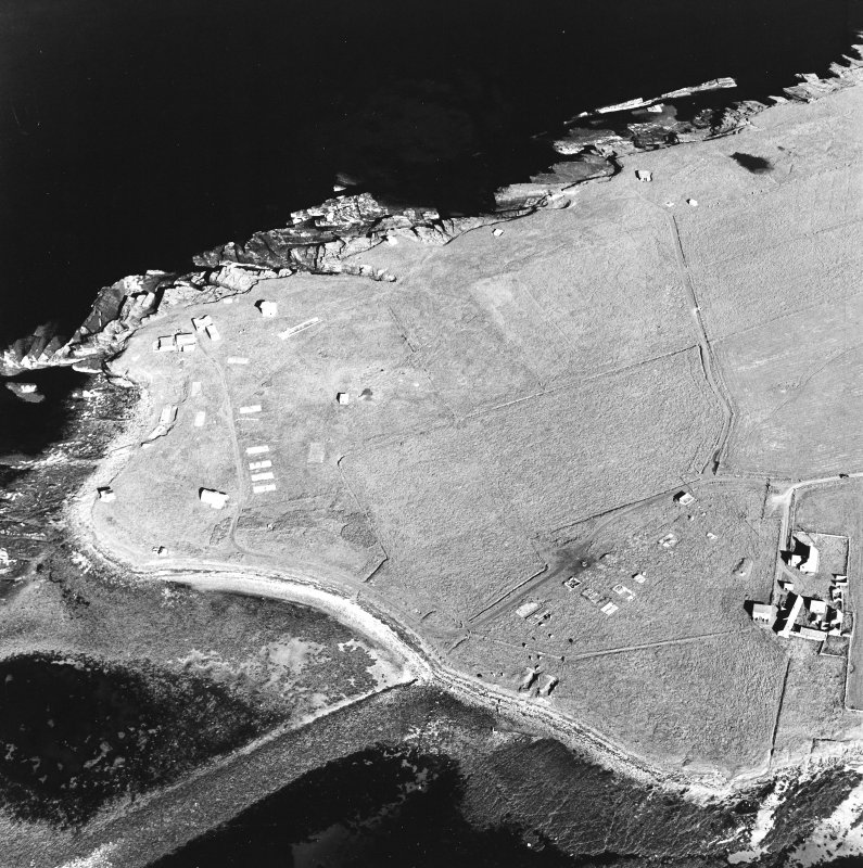 Oblique aerial view of Orkney, Rerwick Head, Rerwick Battery, taken from the NW.  Visible are the gun-emplacements, battery observation tower, searchlight platforms, concrete hut bases for the accommodation camp and two air-raid shelters cut into the shore..