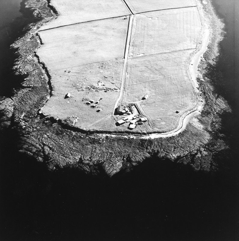 Oblique aerial view of Orkney, Car Ness, Car Ness and Wellington Batteries, taken from the NNE.  Visible are the gun-emplacements, battery observation towers, searchlight platforms and Nissen huts for both batteries. The site of a heavy anti-aircraft battery is just discernable to the S.