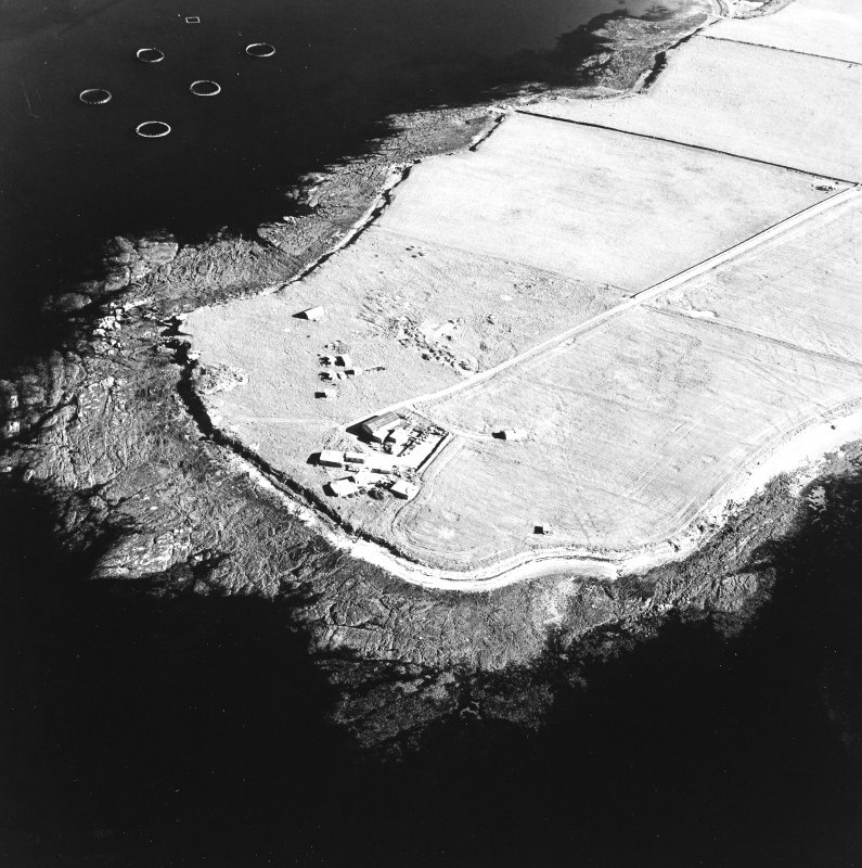 Oblique aerial view of Orkney, Car Ness, Car Ness and Wellington Batteries, taken from the NW.  Visible are the gun-emplacements, battery observation towers, searchlight platforms and Nissen huts for both batteries. The site of a heavy anti-aircraft battery is just discernable to the S.