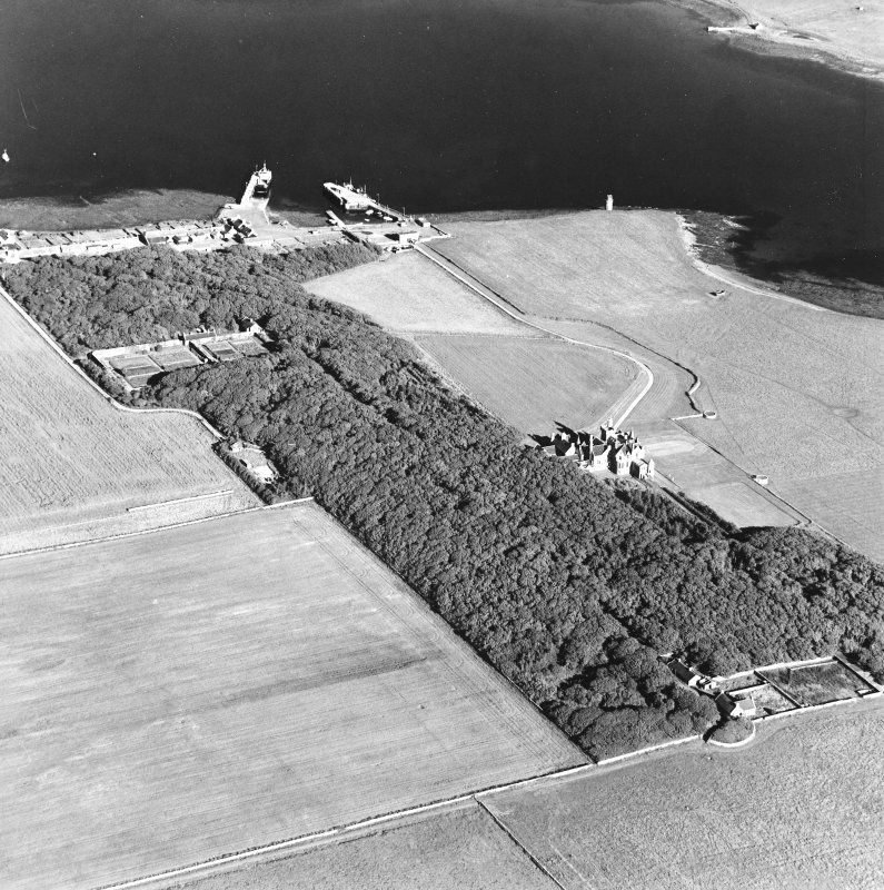 Oblique aerial view of Orkney, Shapinsay, Balfour Castle, Balfour village and harbour taken from the WNW.  Also visible is the Dishan Tower dovecot.