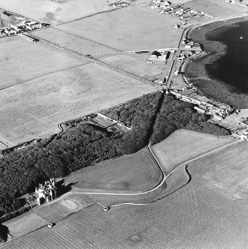 Oblique aerial view of Orkney, Aerial view of Orkney, Shapinsay, Balfour Castle, Balfour village and harbour taken from the SW.  Also visible is the former Balfour village gasometer