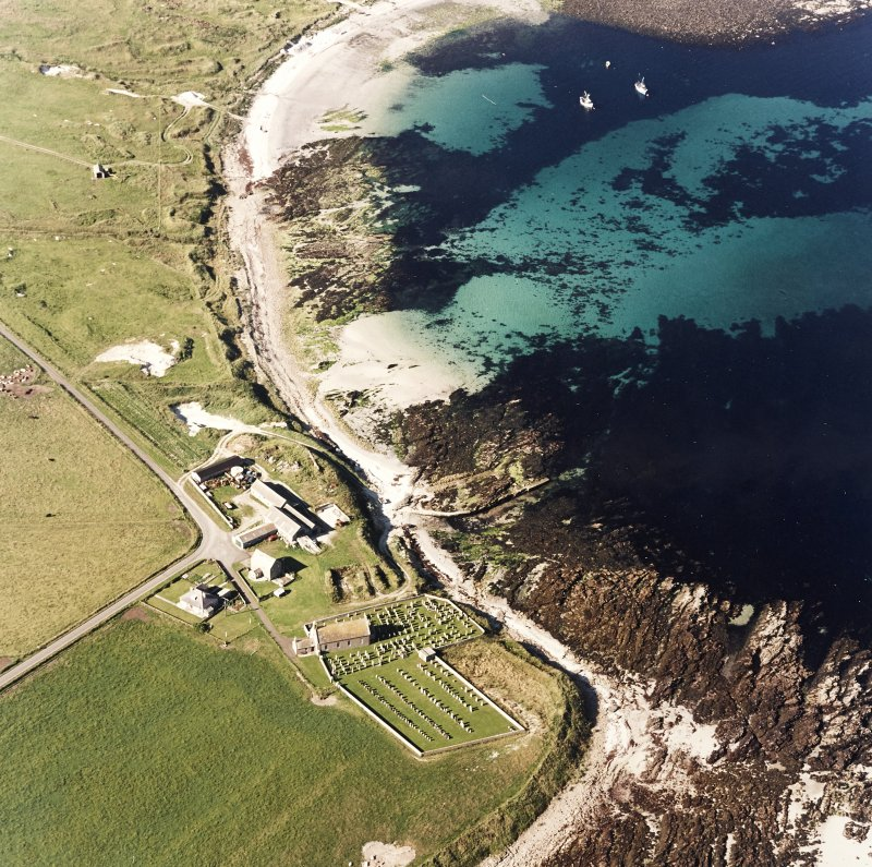 Aerial view of Orkney, Skaill Church and churchyard, taken from the S.  Also visible is the possible broch and Viking settlement site.