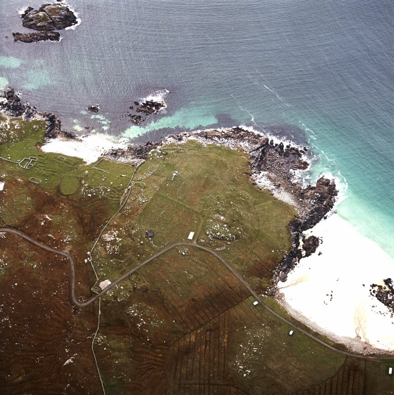 Oblique aerial view centred on the remains of the township and lazy beds with the remains of the radar station and possible nunnery adjacent, taken from the NE.