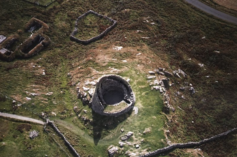 Oblique aerial view centred on the remains of the broch, taken from the N.