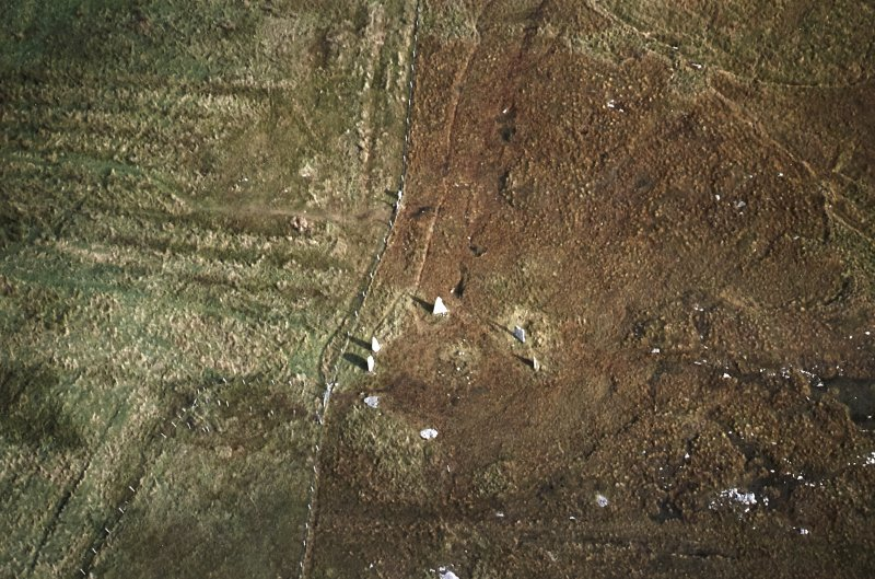 Oblique aerial view centred on the remains of the stone circle with lazy beds adjacent, taken from the WSW.