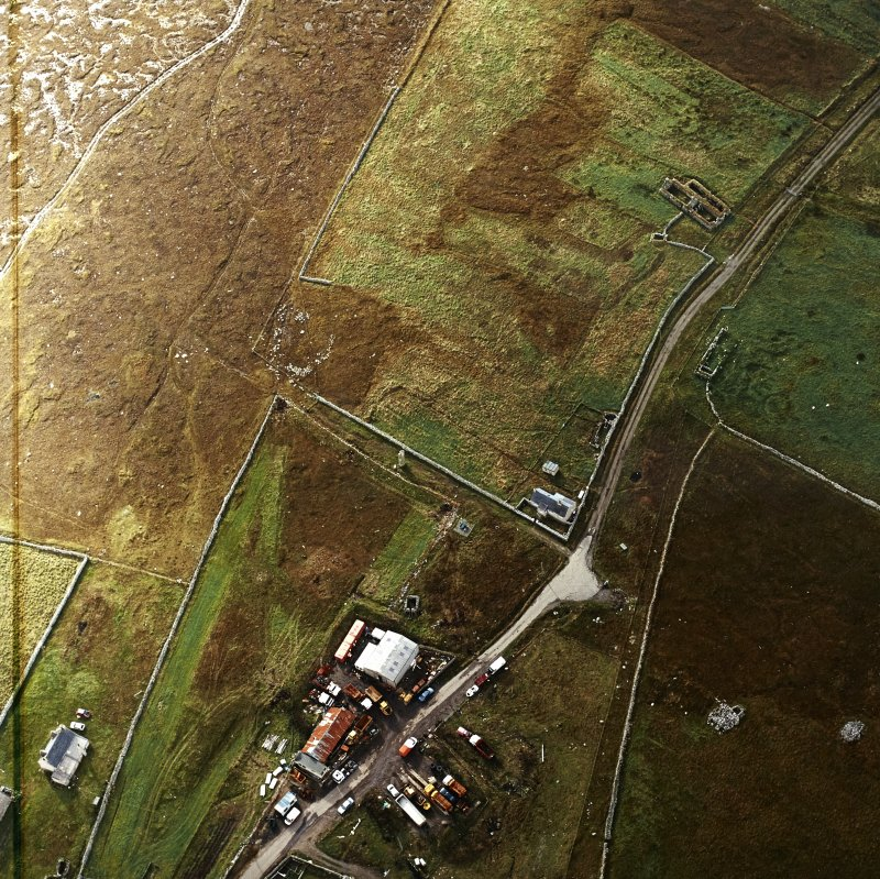 Oblique aerial view centred on the standing stone, taken from the NNE.