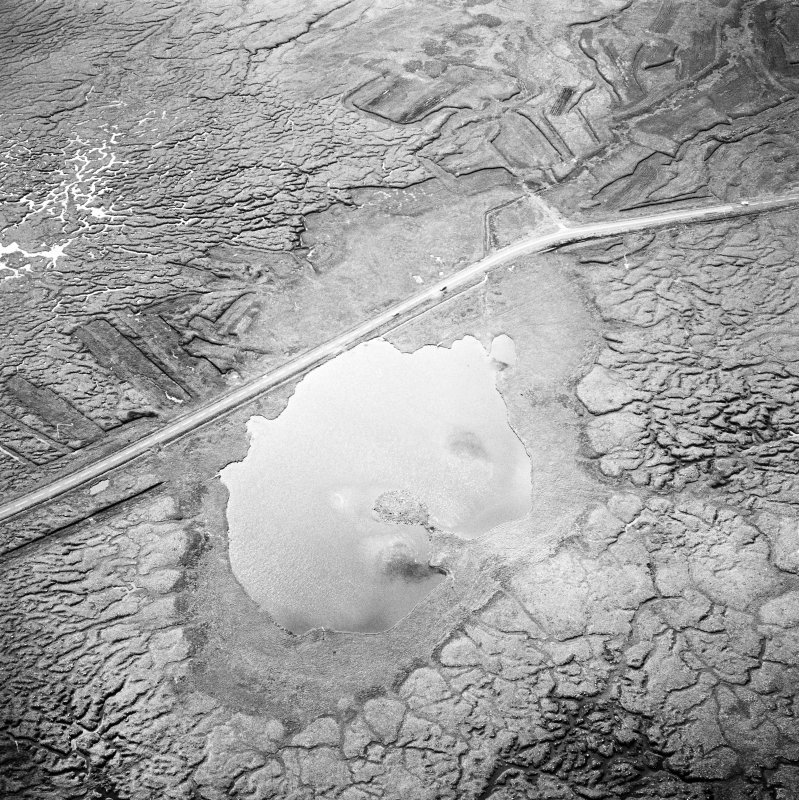 Oblique aerial view centred on the remains of the galleried dun, taken from the NNW.