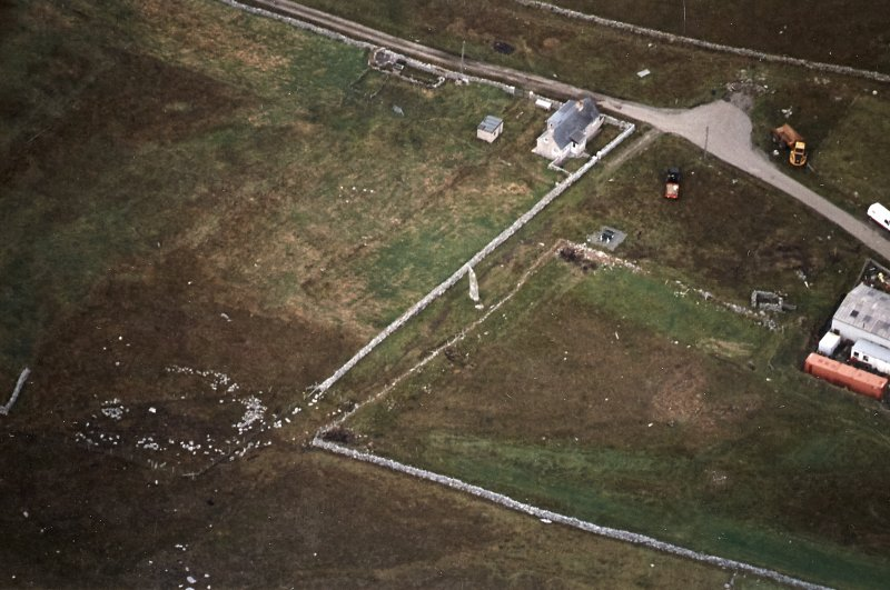 Oblique aerial view centred on the standing stone, taken from the ESE.