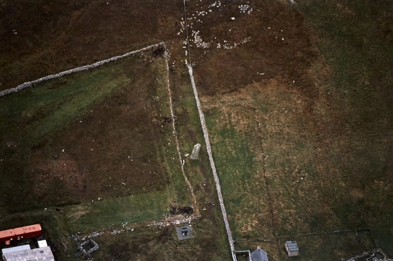 Oblique aerial view centred on the standing stone, taken from the NNW.