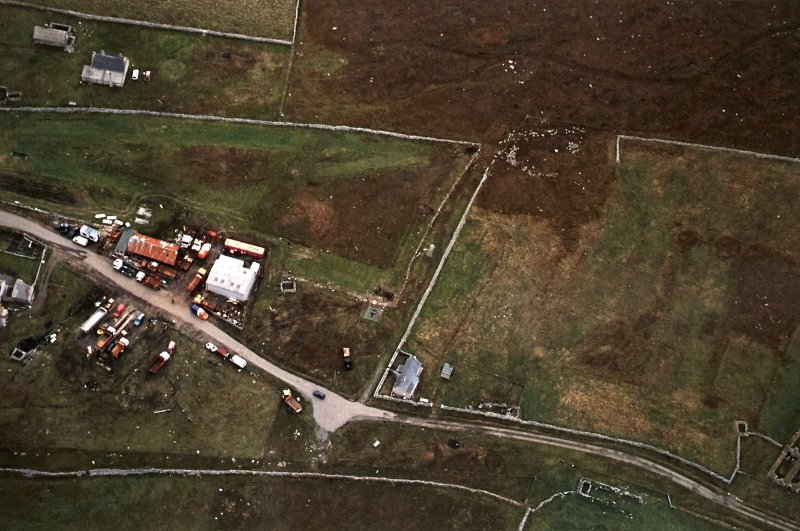 Oblique aerial view centred on the standing stone, taken from the WNW.