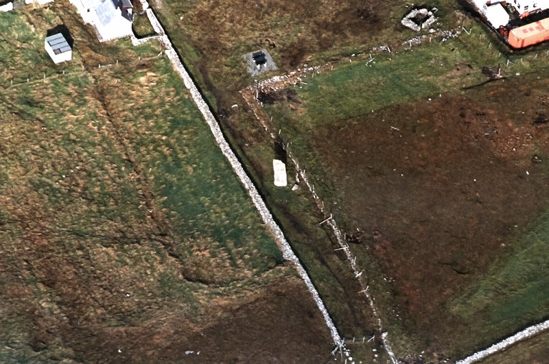 Oblique aerial view centred on the standing stone, taken from the S.