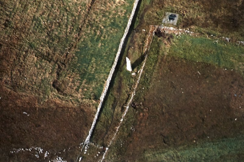 Oblique aerial view centred on the standing stone, taken from the SE.