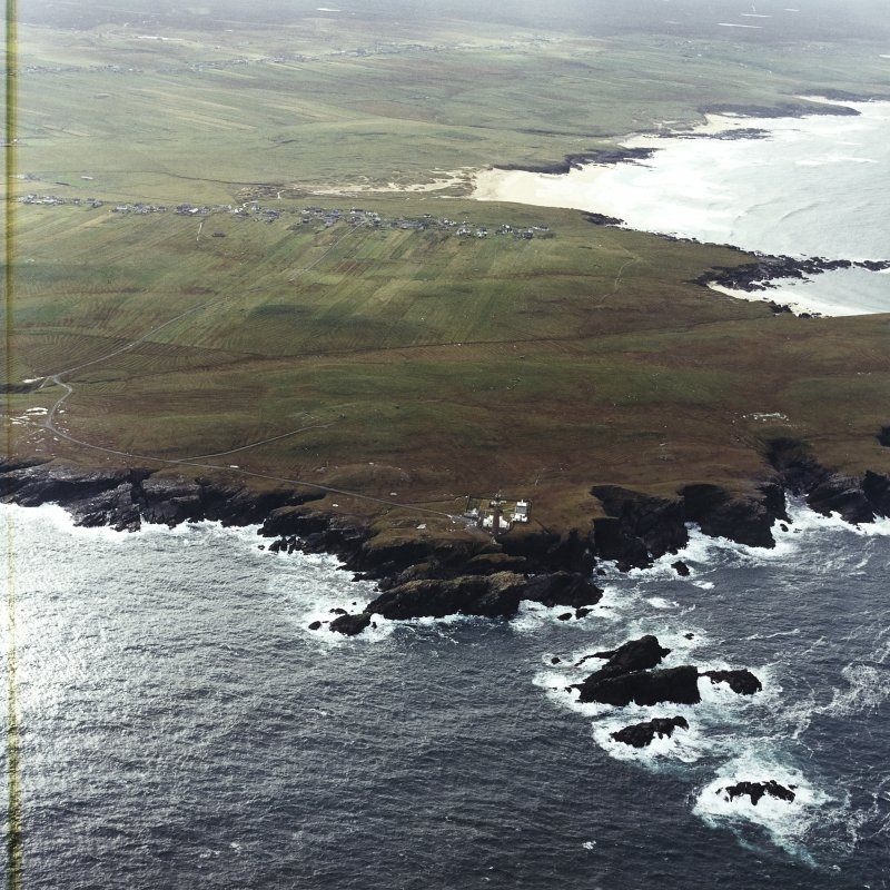 General oblique aerial view looking across the lighthouse towards Eoropie, taken from the NNE.