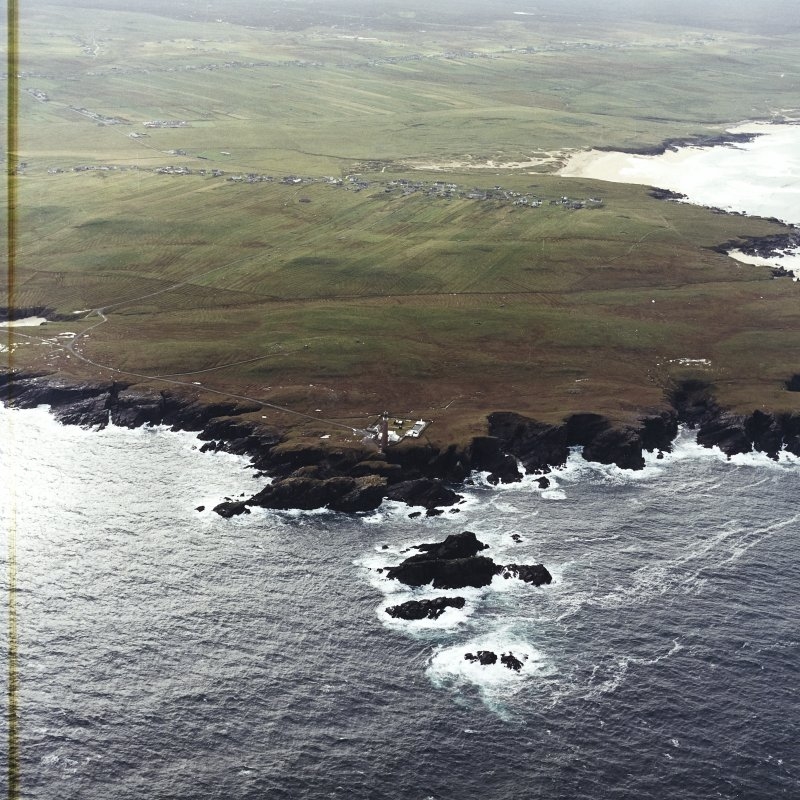 General oblique aerial view looking across the lighthouse towards Eoropie, taken from the N.