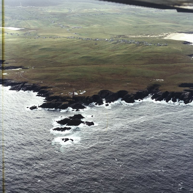 General oblique aerial view looking across the lighthouse towards Eoropie, taken from the NNW.