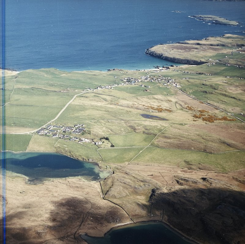 General oblique aerial view looking across the village towards the crofting township and radar station, taken from the WSW.