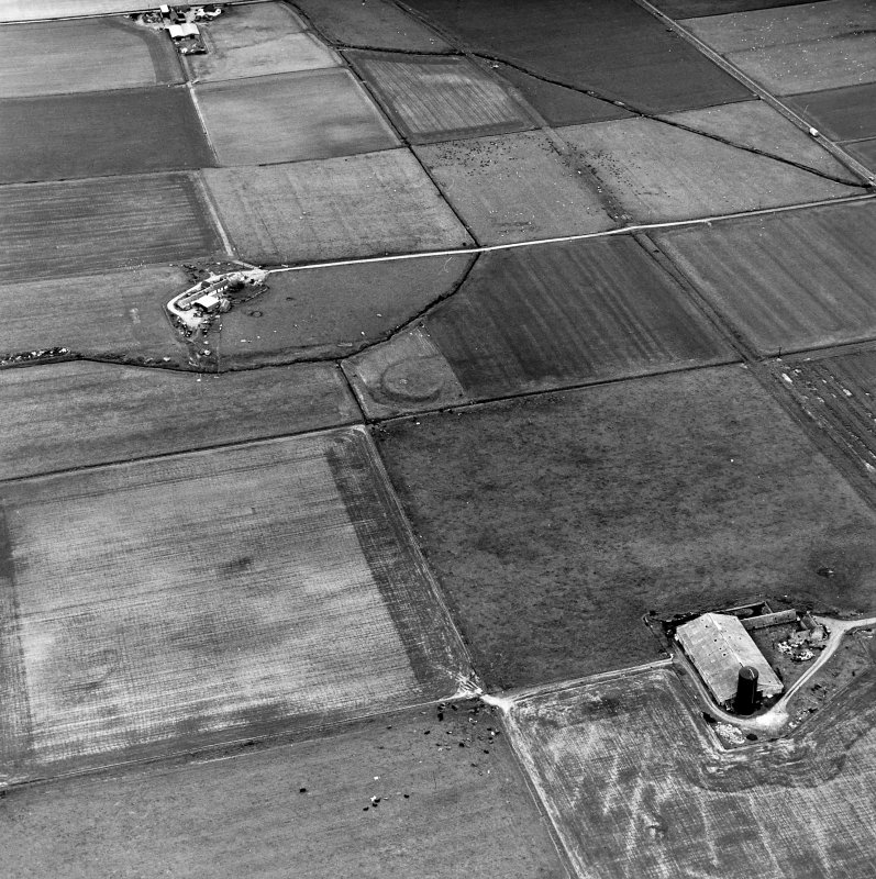 Carin of Humster, oblique aerial view, taken from the SW, showing the remains of a broch in the centre of the photograph.