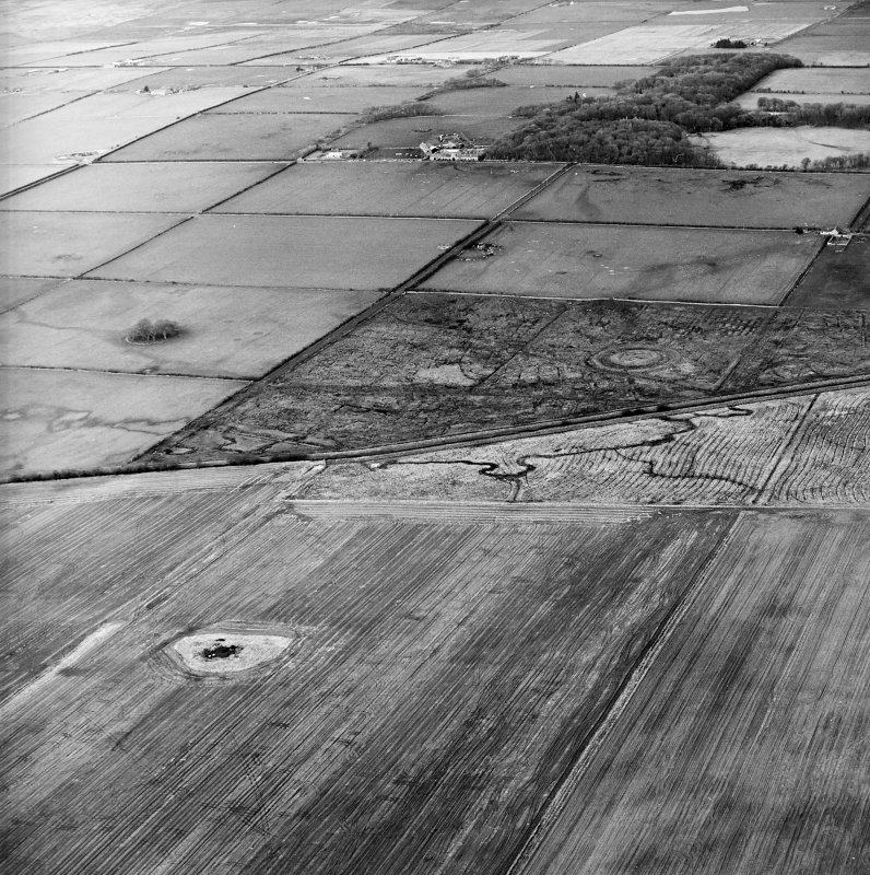 General oblique aerial view looking across the remains of the fort and possible broch towards the country house and farmsteading, taken from the SSE