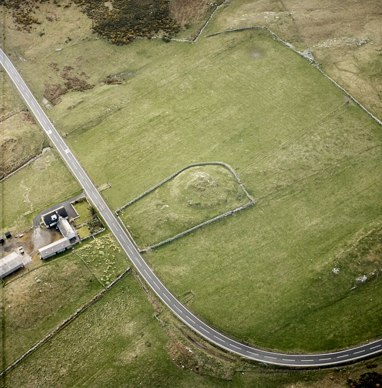 Oblique aerial view centred on the remains of the broch taken, from the NW.