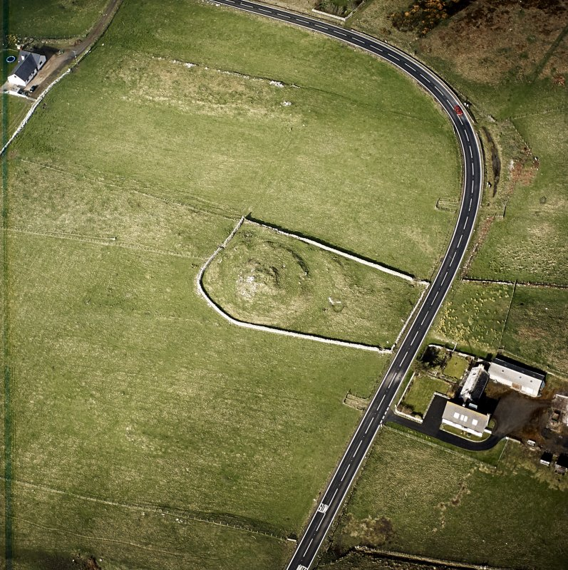 Oblique aerial view centred on the remains of the broch taken, from the E.