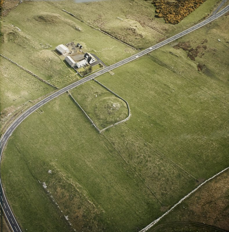 Oblique aerial view centred on the remains of the broch taken, from the WSW.
