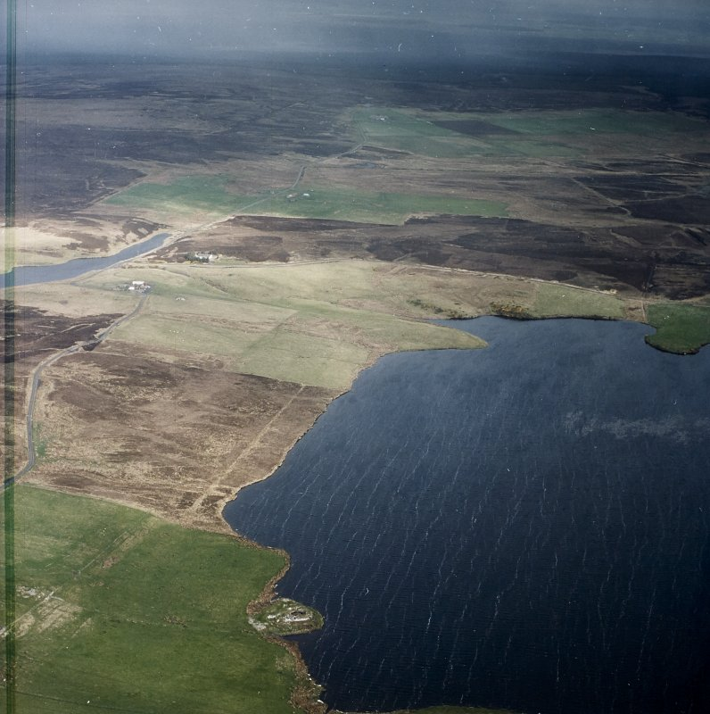 General oblique aerial view looking across the broch and Loch of Yarrows towards Oliclate, taken from the SE.